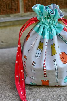 drawstring bag.  Tutorial here http://incolororder.blogspot.com/2011/10/lined-drawstring-bag-tutorial.html