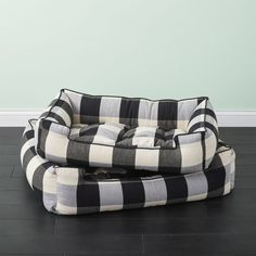Shop Black and White Plaid Dog Bed. Lounges like a sofa and sleeps like a dream. Handcrafted in California by Jax & Bones, buffalo check cotton blend bed feels cushy yet wears tough. Overstuffed with allergy-free fiber, we want to sleep on it, too.