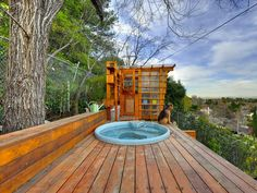 If only I had a view like this.. I'd love to have this hot tub over look deck!!