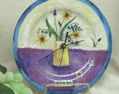 Check out Orange and Blue Flowers in Yellow Vase Theme Kitchen Clock, Upcycled into a Plate Wall Clock, # C6028, (stand is display only) on ckdesignsforyou