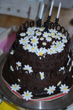 dark choc with daisy flowers and a choc lace collar