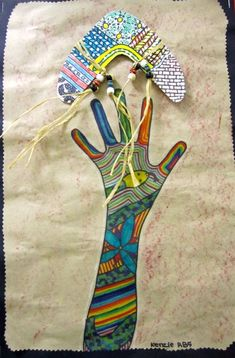 Elementary Art lessons mixed media Australia aboriginal multi-cultural boomerang hands tattoos ... not quite Aboriginal colours or design, but cute idea. Could either do creative design with the arm, or use the arm to re-tell a dreamtime story using appropriate colours and interpretations.