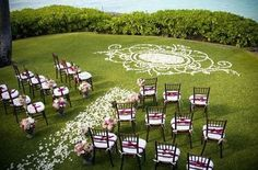 Weddings can happen anywhere with the right ground petal arrangement.