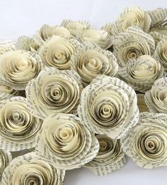 Vintage Paper Flowers — Set of 50 by Krista Mae Studio~  Vintage Paper Flowers — Set of 50 Made from the pages of vintage books We're not saying that decorating for a wedding is easy — but these darling paper flowers should certainly help make it seem that way. They're carefully fashioned by hand from the pages of vintage books, lending a rustic and romantic feel to any decor. Set of 50 for $38.00