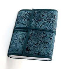 Record special memories with this cruelty-free leather journal. Handmade by artisans in India, this beautiful indigo-blue journal features 100 sheets of handmade, parchment-like paper and is held securely closed by a stylish leather band.