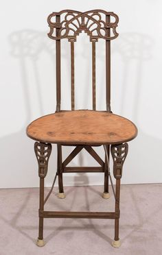 Set of Four Art Nouveau Cast Iron Folding Chairs with Wood Seats | From a unique collection of antique and modern chairs at https://www.1stdibs.com/furniture/seating/chairs/