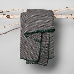 You'll want to sit back, relax and stay awhile when you have this Black Woven Throw Blanket from Hearth & Hand™ with Magnolia to snuggle with. The black and white throw blanket is given a pop of color from the green stitching along the edges, making it the perfect piece for your living space. When you're not cozied up, drape it over your couch or accent chair for a soft, warm accent that'll put the finishing touch on your home's interior.<br><br>Celebr...