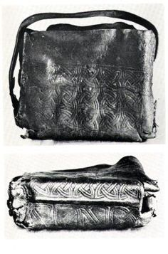 bag is from Breac Moedoic and dates to 8th or 9th century, rather than a book it actually contains a portable metal shrine so should be called a Cumbach or reliquary . The bag is made from an oblong piece of tanned Leather, probably dyed brown or black, and tooled. The internal dimensions would originally have been approximately 30 x 25 x 4 cm.