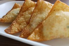Crab Rangoons- 12 ounces of cream cheese (at room temperature) 50 wan ton wrappers 1 cup imitation crab meat (or canned) 2 green onions (minced) ¼ teaspoon garlic powder ½ teaspoon soy sauce 1 egg (beaten) oil (for frying