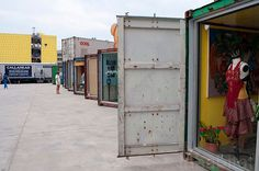 DeKalb Market: Shipping Container Stores ...just needs some aesthetic attention.  containers need paint or cover that insulates.  stores need lighting (green powered), the lot needs plants and papercrete plus shipping pallet furniture and decor.  offices and housing stack on top of stores.