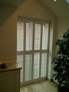 French doors with traditional range shutters