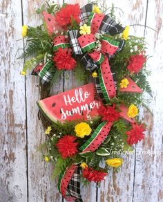 This scrumptious watermelon wreath will be a show stopper and delight your guests making them feel warm and welcomes coming into your home.  #summerwreath #watermelonwreath #frontdoorwreath, #watermelondecor #grapevinewreath