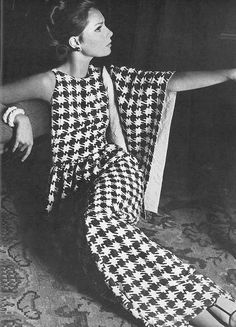 Actress and model Jennifer O'Neill in a Mainbocher navy and white houndstooth, silk matelasse evening gown with matching stole, photo by Horst P. Horst, for Vogue, 1965.