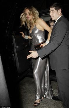 Silver linings: The actress appeared to go braless as her dress plunged low in the front...