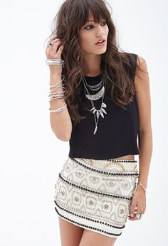 Beaded Mini Skirt. Love this color, but the black skirt with cream/white beading is a lot cuter!! (on XXI website)