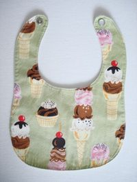 "I just used this pattern to make a bib to go with the burp cloths from the same site (and previously pinned).  It turned out great and was very easy!  I used ""Babysaurus"" fabric (from fabric.com) and appliqued a dinosaur on front.  Adorable!"