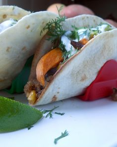 Smoky Sweet Potato Tacos with Maple Cream are healthy, savory, and deliciously satisfying. Roasted sweet potatoes with smoked paprika, avocado & black beans