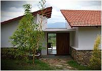 """Bandipur Eco Home designed con temporarily maintains a perfect harmony with the nature and completely utilizes natural sources for its major sustenance. It's a perfect getaway in the mid of wilderness, with every room aesthetically designed overseeing mystical landscape view of """"Nilgiris Range""""."""