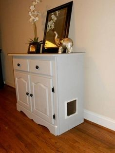 Cat cabinet. So clever! Houses litter box and prevents litter from being tracked..
