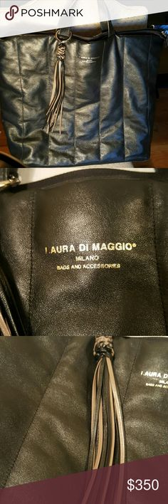 Laura di Maggio hand made leather tassel satchel L16 W6 H15.5       NWOT, never carried. haven't had a chance to use it. Perfect for a Jet set individual. Hand made in Italy. Beautiful soft leather designer bag. I have the price tag somewhere, have to remember where I put it when I moved. Excellent quality. XL in size, this bag is huge ! Dust bag included Smoke free pet free home Dooney & Bourke Bags Satchels