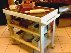 This multi tiered pallet wood upcycled kitchen island has got it all that was supposed to be offered. Place almost all of your immediate kitchen accessories here, hang some of the pans and utensils on the hooks on side, and grab it right there wherever you are working.