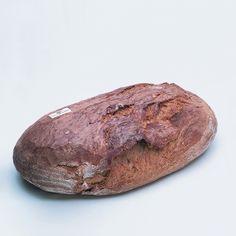Chleb owalny Chleb powszedni. Mocno wypieczony, o spękanej, chrupiącej skórce.