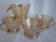 4 vintage depression glass Jeanette Floragold Louisa punch cups teacup. $12.00, via Etsy.