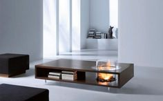 Coffee table with a built-in glass fire pit. I like this but wouldn't it burn your house down :/