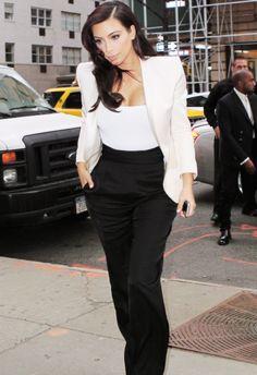 Kim Kardashian & Kanye West right behind her