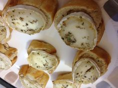 Warm goats cheese on baguette slice with honey and herbes de Provence -