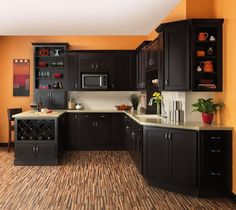 This is the exact color scheme i want for my kitchen! very warm and homey yet modern and stylish. except id add a nice backsplash to it.   Orange Kitchen Wall Decoration and Dark Furniture in Modern Kitchen Cabinets Ideas for Storage