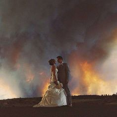 "Monday, June 09, 2014 BEND, Ore. -- Michael Wolber and April Hartley had to evacuate from their own wedding as a wildfire burned in Bend, Oregon on Saturday - but not before getting a few pictures!  According to photographer Josh Newton.  However, just as the bride was about to walk down the aisle, a fire truck came in with sirens blaring.  ""I've never seen anything like what happened next. Everyone moved the entire wedding to a park in Bend, all with smiles and good attitudes,"" Newton said."
