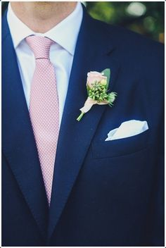 A blue suit worn with a pink tie is remarkable.