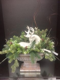 Ceramic / pottery deer in urn with greenery.Rustic Glam Collection, 2016 floral design, Tara Powers Michaels of Midlothian, Va. Christmas Planters, Outdoor Christmas, Rustic Christmas, Christmas Projects, Winter Christmas, Vintage Christmas, Christmas Time, Christmas Urns, French Country Christmas