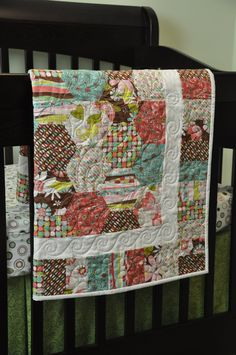 "Modern baby girl quilt, chic baby quilt, hexagon quilt, flowers, pink, brown, blue, white, ""Chloe"". $130.00, via Etsy."