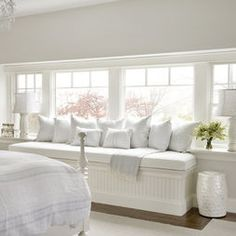 Pristine white bedroom window seat with storage underneath. Lovely for glamour sessions