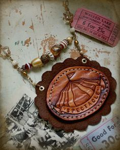 Spectacle - leather & fiber carnival necklace. $50.00, via Etsy.
