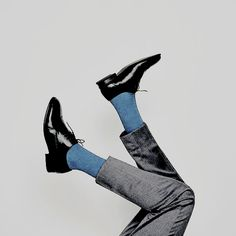 someone with their feet in the air, grey, black, blue