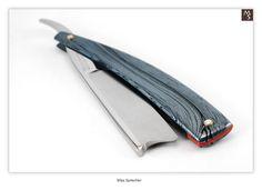 This is a beautiful straight razor.  Max Sprecher Custom Spanish Point - 7/8 - 1/4 Hollow w/Cobaltium M3 Mokume Gane scales - Shave Ready