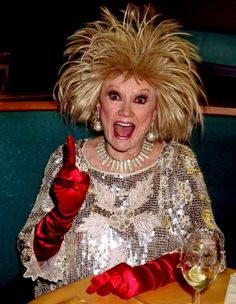Bewigged comedienne Phyllis Diller died August 2012 at age Famous for her variety of wigs, outrageous outfits, bejeweled cigarette holder and in her later years, for a variety of plastic surgery procedures that entirely changed her appearance. Phyllis Diller, Female Comedians, Sweet Charity, Celebrity Deaths, Hollywood Actor, Celebs, Celebrities, Vintage Hollywood, Plastic Surgery