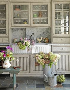 distressed cabinets + glass doors (only one or two, for the pretty things)