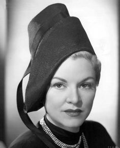 Claire Trevor and a stylish chimney pot. She doesn't even look happy to be wearing it.