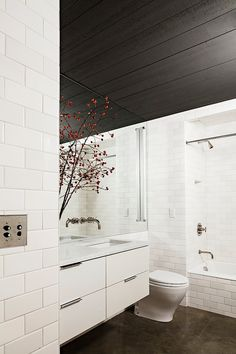 NW 13th Avenue Loft by Jessica Helgerson Interior Design: subway tiles and push button light switch