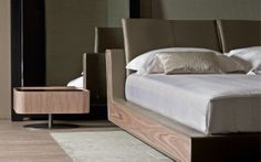 "Outstanding style features characterize this important double-size bed: its clean lines were inspired by the Seventies and declined in a contemporary modern style. [Double bed ""Sama"" with lateral edges in Canaletto walnut. Design by Cuno Frommherz] #Bedroom #InteriorDesign #HomeDecor #Design #Arredamento #Furnishings #seventiestyle #seventies #annisettanta #canaletto #legno #wood"