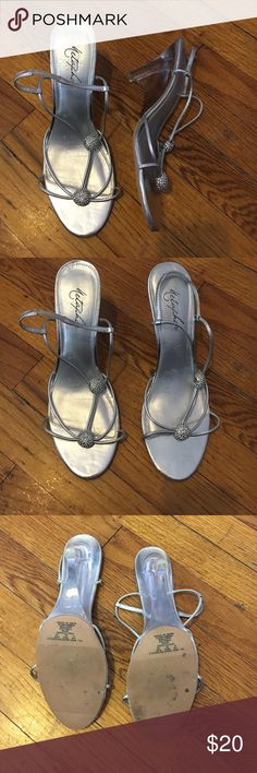 Silver heels Liver heels! Clear heel! Kinda chunky heel! Silver ball detailing in front! Size 8 could fit a 7 perfectly! Used! Some tears on the side of shoe other then that in great conditions! Macy's Shoes Heels