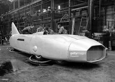 24th August 1937, Tipton, Staffordshire, The mightiest car ever built is pictured near completion at the factory in the Black country, The car is to be driven by Captain George Eyston in an attempt on the land speed record set by Sir Malcolm Campbell of 301 MPH, It is hoped that the new 36 foot long 3,000HP eight-wheeled machine will reach a speed of 400MPH