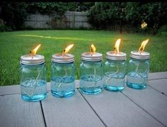 Aren't these mason jar lanterns beautiful? Retro reproduction mason jars in a lovely shade of blue are filled with liquid citronella. A hole in punched in the flat cap of a 2 part lid, c...