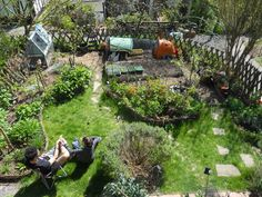 May 2013. In my small 25x30ft space, I've managed to create garden that is low maintenance and very productive using permaculture design. Looking down on the garden you can't quite see the raised beds full of annual veg from here (at the bottom) but you can see the lay-out I've designed to maximise food growing space (lots of perennials for a forest garden style polyculture) and still provide some space for relaxing in the sun. We've also managed to squeeze in some chickens too!