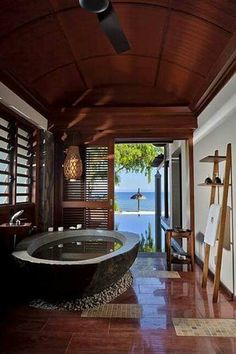 Warm Wood Floors to enjoy the view in your Relaxing #Bath. www.remodelworks.com
