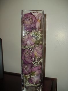 I dried roses and baby's breath, I used an old vase and organized them for a center piece that has memories stuffed inside.